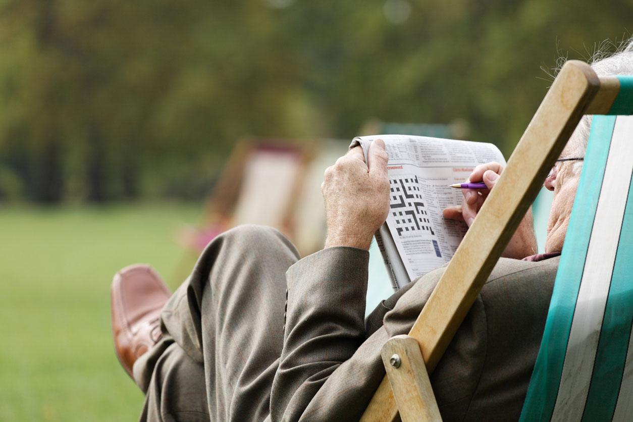Man Doing Crossword Puzzle